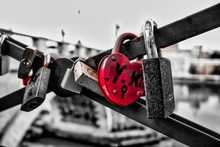 Close Up Of The Red Heart Padlock Locked On The Rail Bridge, Symbol And Promise For Eternal Love.