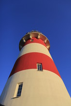 Red And White Lighthouse With Blue Sky
