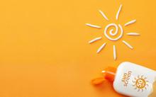Sunscreen On Orange Background...
