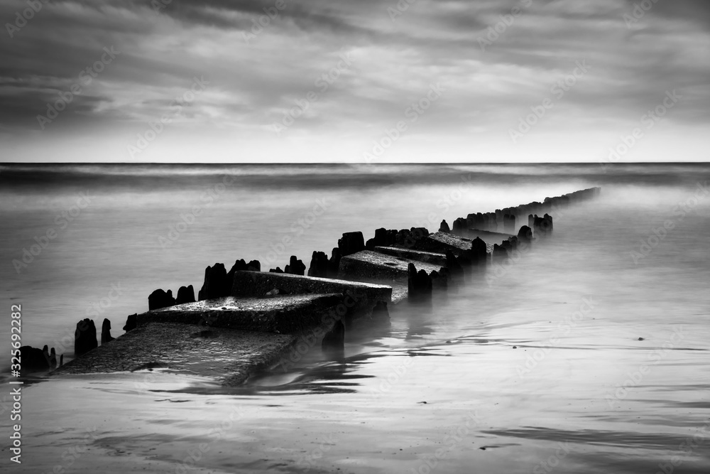 Fototapeta Long exposure shot of the sea and a pier, black and white photo, Baltic Sea, Poland