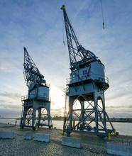 Old Cranes In The Harbour Of Antwerpen Belgium