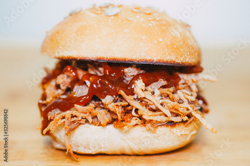 hands holding Pulled Pork Hamburger bbq and beer Canvas Print