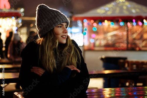 Obraz na plátne photo with grain and aberrations under the old photo, film photo beautiful girl in a hat with coffee in the evening, basks, near the Christmas tree, winter holidays, holiday and walks