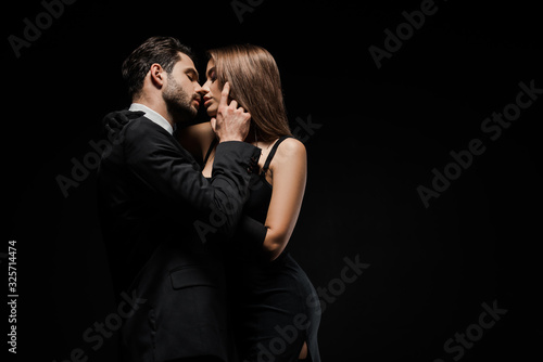 side view of handsome man touching face of attractive woman in dress isolated on Wallpaper Mural