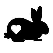 Vector Illustration Of A Rabbit Silhouette With A Cut Out Heart.