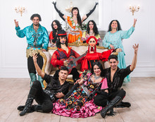 Dance Group In Gypsy Costumes With Bright Big Dolls