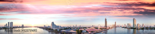 Fototapeta Bangkok, Thailand. Aerial view of cityscape and Chao Phraya River ar sunset obraz