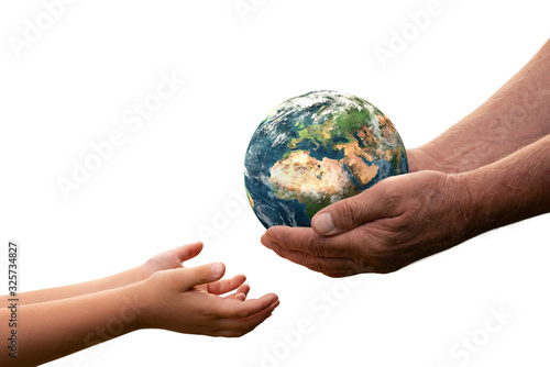 Close up of senior hands giving small planet earth to a child isolated on white background