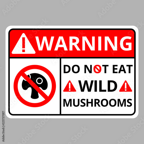 Photo Warning this area is do not eat wild mushrooms sign danger on soft gray background