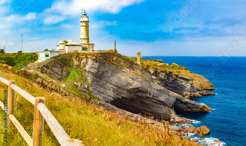 Countryside and cliff in Santander.Tour tourism in Cantabria,Spain.Beautiful natural landscape Cabo Mayor Lighthouse.Scenery coastline and evening sky.