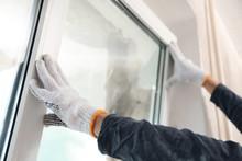 Worker Installing Plastic Window Indoors, Closeup View
