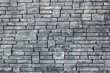 gray brick wall with rough texture