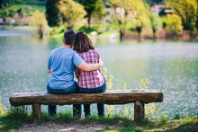 Young Couple Sitting On Bench ...