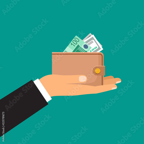 Male hand holds a wallet with money #325781673