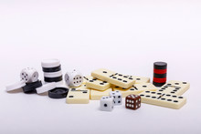 Various Board Games Chess, Dice And Dominoes On A White Background.