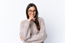 Young Brunette Woman Over Isolated White Background With Glasses And Smiling