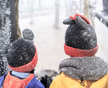 Two Kid In Winter Clothing Is ...