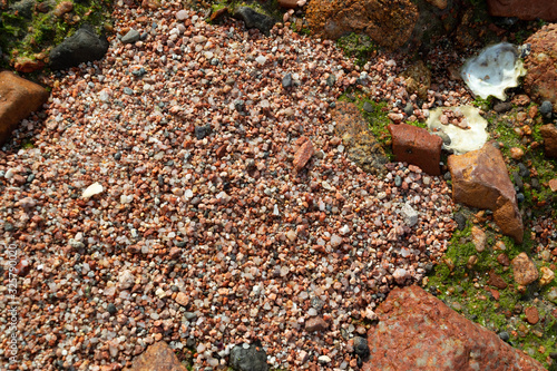 Valokuva Red Sand and Stones of the red Sea Coast, Natural Texture Background