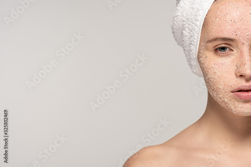 Fotografie, Obraz beautiful girl with coconut scrub on face and towel on head, isolated on grey