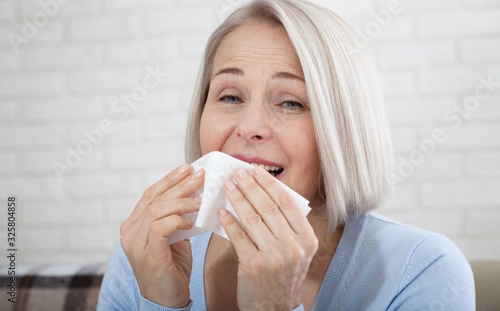 Valokuvatapetti Healthcare, cold, allergy and people concept, sick woman blowing her runny nose