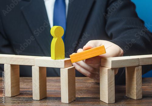 Mentor removes obstacle on a way of yellow man Canvas Print