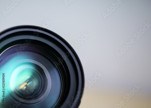 dslr zoom lens front view with copy space Wallpaper Mural