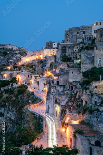 Matera, European Capital of Culture 2019. Old town listed as World Heritage by UNESCO, Sasso Barisano at night, Basilicata, Italy - 325821224