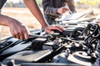 Technician team working of car mechanic in doing auto repair service and maintenance worker repairing vehicle with wrench, Service and Maintenance car check