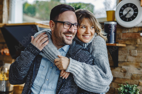 Portrait of embraced couple in the kitchen. Canvas Print
