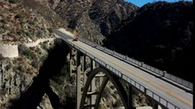 Gorgeous Sports Car Races Over A Mountain Bridge Outside Of Los Angeles