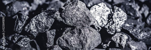 Fotomural Coal miner in the man hands of coal background. Coal mining