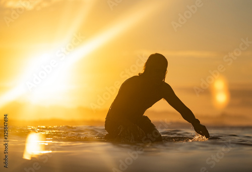 Surfing the sunrise in Costa Rica - 325847694