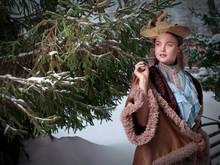 Beautiful Russian Woman In A Vintage Dress. Russian Village. Winter.