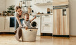 Leinwandbild Motiv Happy family mother housewife and child   in laundry with washing machine