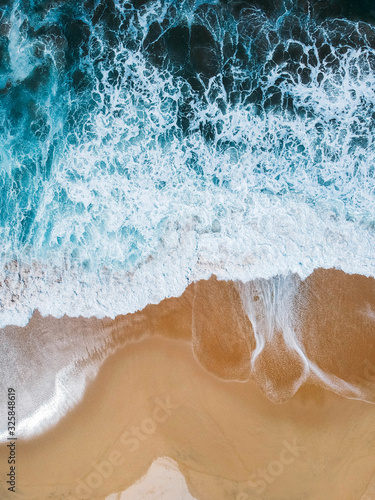 Aerial drone view of beach and ocean waves crashing no people - 325848619