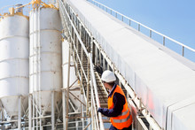 Concrete Worker With Helmet In Concrete Plant