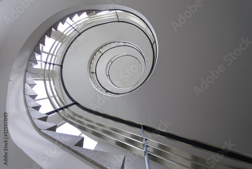 Spiral white staircase from ca 1950. Taken from below with visible black stair railing