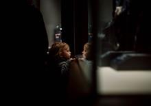 Toddler Looking Through Glass ...