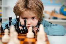 Little Boy Playing Chess. Kids...