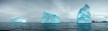 Panorama With Three Giant Icebergs In Strait In Antarctica
