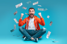 Young Attractive Bearded Man Celebrating Victory After Betting At Bookmaker's Website