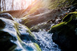 canvas print picture - water flowing over rocks