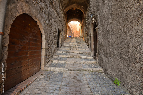 Vászonkép Anagni, Italy, A narrow street between the old stone houses of a medieval village