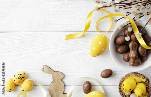 easter eggs on wooden background, copy space for text Wallpaper Mural