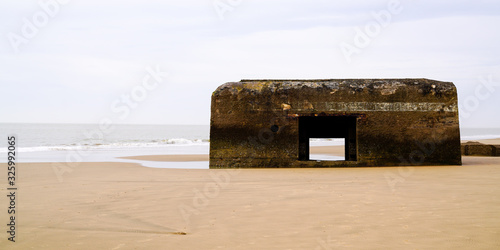 Photo german old Blockhaus in sand beach in french atlantic coast wwII blockhouse