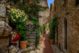 Fototapeta Uliczki - Old buildings on narrow streets in the medieval city of Eze Village in the South of France along the Mediterranean Sea