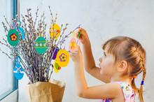 Little Girl Hanging Easter Egg...
