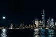Amazing panorama view on New York City skyline and Downtown Manhattan from Jersey City during night and Full Moon