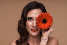 Beauty Portrait Of Gorgeous Adult Half-naked Woman Holding Red Flower