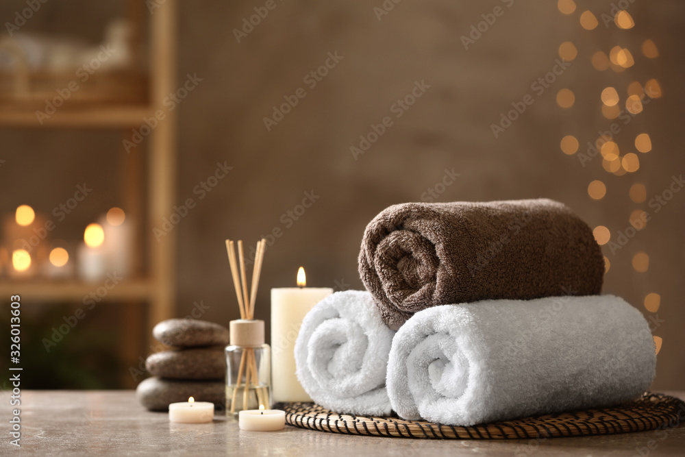 Fototapeta Beautiful composition with spa stones on grey marble table